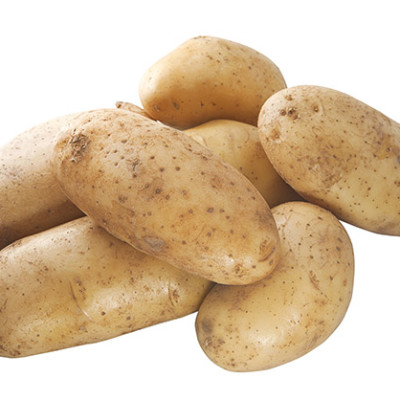 Close up fresh potatoes isolated on a white background.